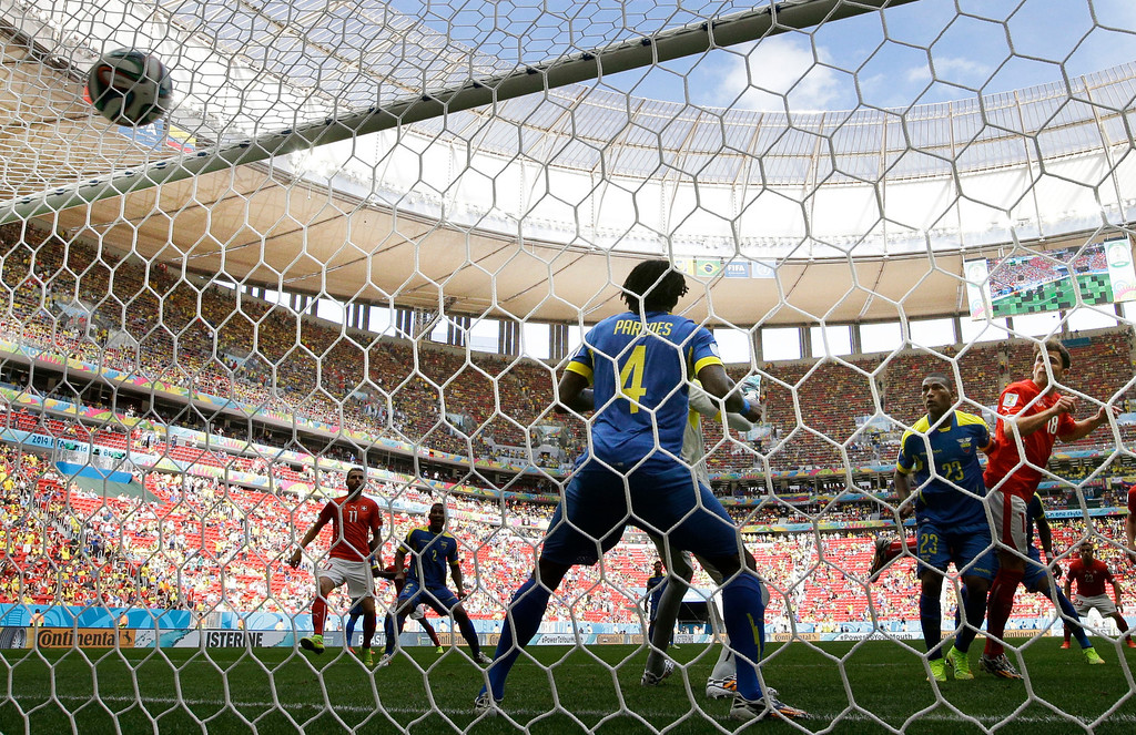 . Switzerland\'s Admir Mehmedi, right, scores his side\'s first goal during the group E World Cup soccer match between Switzerland and Ecuador at the Estadio Nacional in Brasilia, Brazil, Sunday, June 15, 2014. (AP Photo/Michael Sohn)