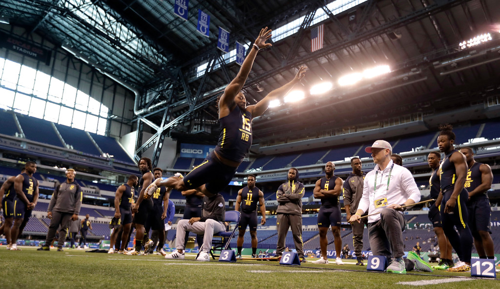 . Utep running back Aaron Jones is tested in the broad jump at the NFL football scouting combine Friday, March 3, 2017, in Indianapolis. (AP Photo/David J. Phillip)