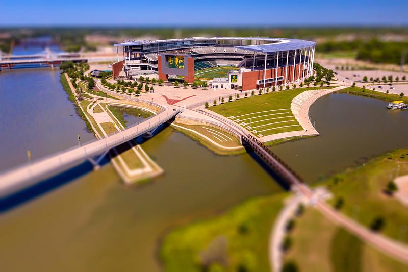 McLane Stadium - Sheila and Walter Umphrey Pedestrian Bridge - Brazos River - miniature, drone, aerial