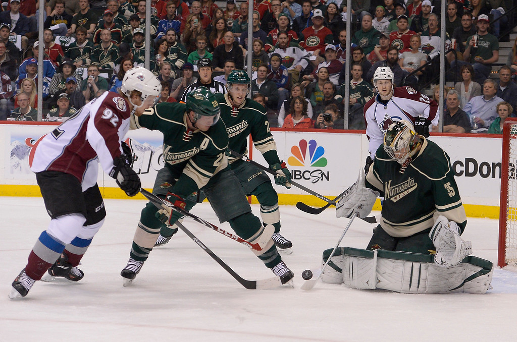 . Minnesota Wild defenseman Ryan Suter (20) defends as Colorado Avalanche left wing Gabriel Landeskog (92) pokes at the puck as Minnesota Wild goalie Darcy Kuemper (35) makes a save during the first period April 21, 2014 during round 1 game three of the Stanley Cup Playoffs at Xcel Energy Center. (Photo by John Leyba/The Denver Post)