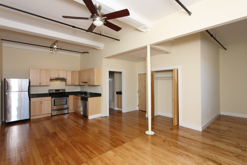 North Dam Mill apartments - Wide view of kitchen, bathroom, living room and dining area.