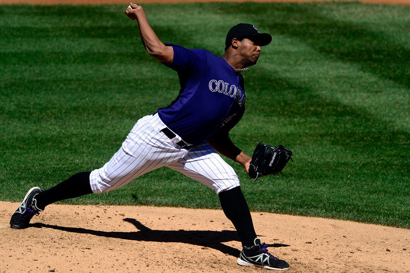 . Colorado Rockies starting pitcher Juan Nicasio (44) fires a pitch against the San Diego Padres during the third inning in Denver. The Colorado Rockies hosted the San Diego Padres at Coors Field on Sunday, June 9, 2013. (Photo by AAron Ontiveroz/The Denver Post)
