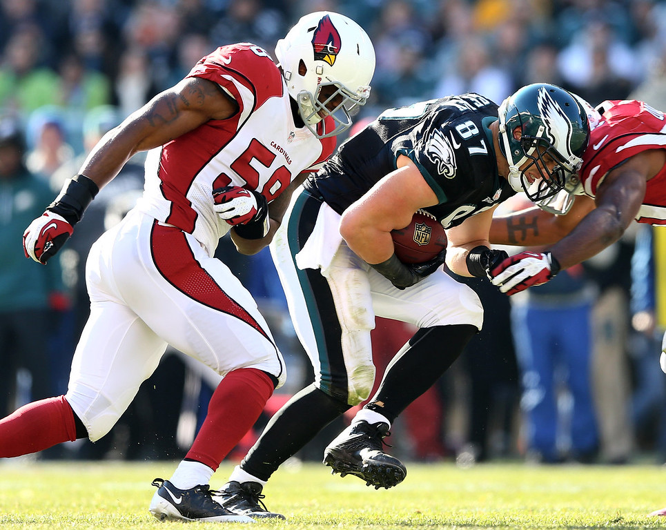 . Brent Celek #87 of the Philadelphia Eagles tries to get a few extra yards as Karlos Dansby #56 and Daryl Washington #58 of the Arizona Cardinals defend on December 1, 2013 at Lincoln Financial Field in Philadelphia, Pennslyvania.  (Photo by Elsa/Getty Images)