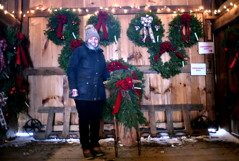 Groton Woman's Club member Margaret Gorini of Groton, stands by a decorated old time sled that will be on sale at the clubs 14th Annual Hoilday Greens Sale at Williams Barn on Sat. SUN/ David H. Brow