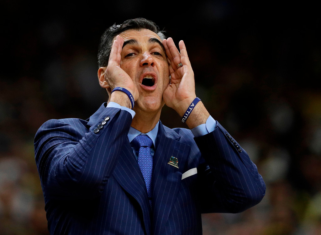 . Villanova head coach Jay Wright directs his team during the first half against Michigan in the championship game of the Final Four NCAA college basketball tournament, Monday, April 2, 2018, in San Antonio. (AP Photo/David J. Phillip)