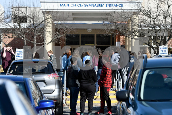 3/14/2018 Mike Orazzi | Staff Bristol Eastern High School students while walking out of school Wednesday to mark the one month anniversary of the Parkland school shooting. Students planned to stay outside for 17 minutes, one minute for each victim, they also want more gun control.