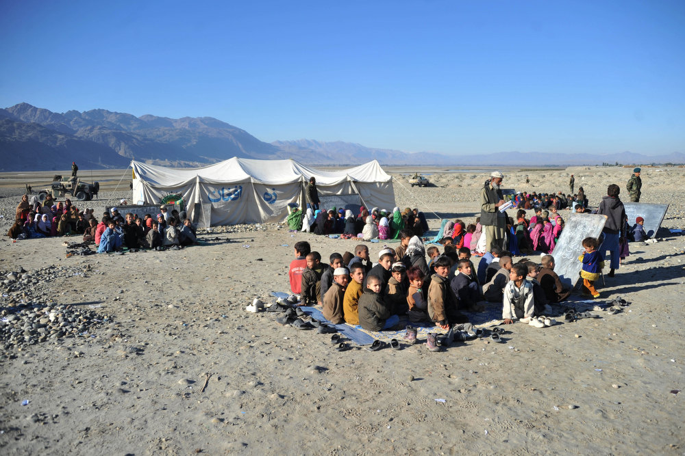 Description of . Afghan teachers hold their respective outdoor classes in the outskirts of Mihtarlam on December 19, 2012.  Decades of war and conflict in Afghanistan have destroyed hundreds of schools and colleges and many of those who are well-educated have fled to other countries, causing a severe brain drain in the country. Noorullah Shirzada/AFP/Getty Images