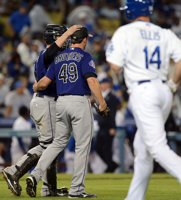 . The Rockies\' catcher Jordan Pacheco #15 and closer Rex Brothers #49 celebrate the victory over the Dodgers during their game at Dodgers Stadium Saturday, September 28, 2013. The Rockies beat the Dodgers 1-0. (Photo by Hans Gutknecht/Los Angeles Daily News)