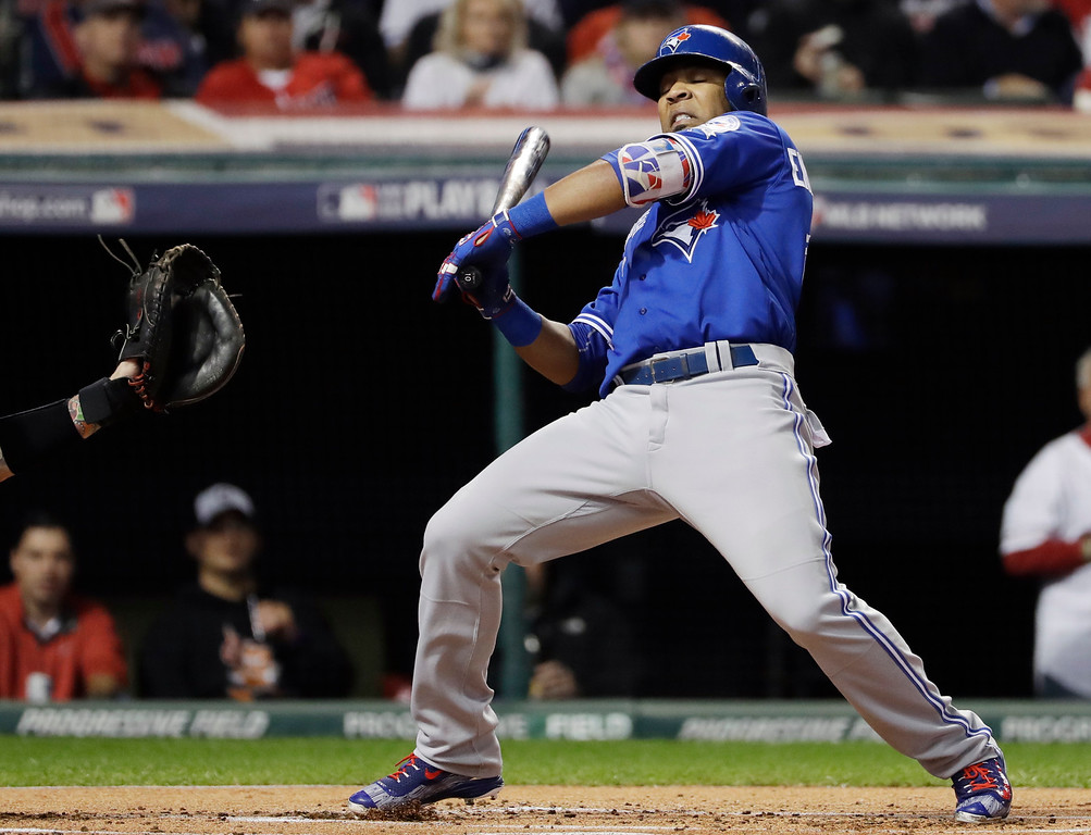 . Toronto Blue Jays\' Edwin Encarnacion gets out of the way of a inside pitch during the first inning in Game 1 of baseball\'s American League Championship Series against the Cleveland Indians in Cleveland, Friday, Oct. 14, 2016. (AP Photo/Matt Slocum)