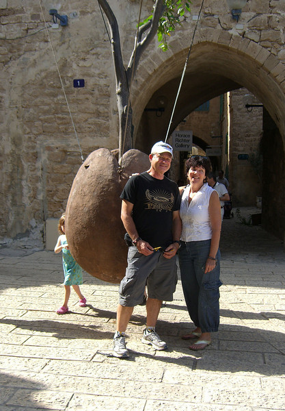 33-Roni and Hadas pose in front of a live tree growing from an oversize sculpted nut.