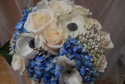 Blue hydrangea, white anemone with black center, Baby breath ivory rose $125