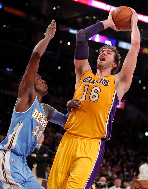 . Los Angeles Lakers forward Pau Gasol (16), of Spain, takes a shot with Denver Nuggets forward Quincy Miller defending in the second quarter during an NBA preseason basketball game Sunday, Oct. 6, 2013 in Los Angeles. (AP Photo/Alex Gallardo)