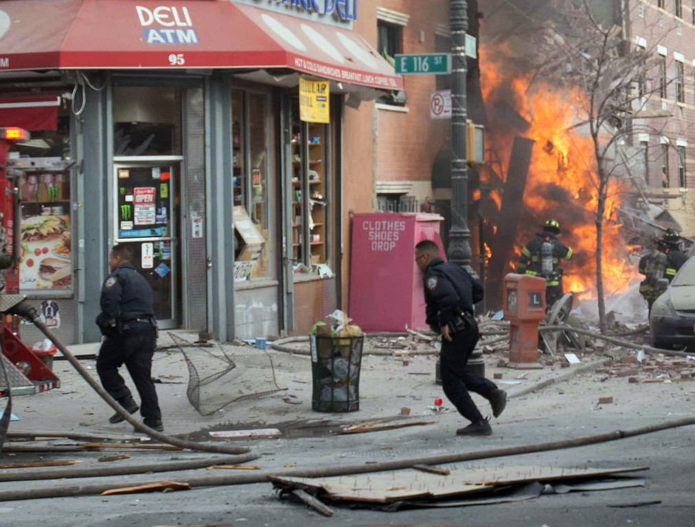 . Emergency crews respond to an explosion that leveled two apartment buildings in the East Harlem neighborhood of New York, Wednesday, March 12, 2014. The blast happened after a neighbor reported smelling natural gas. (AP Photo/Jeremy Sailing)