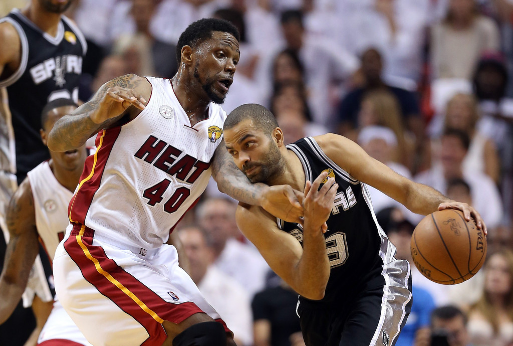 . Tony Parker #9 of the San Antonio Spurs with the ball against Udonis Haslem #40 of the Miami Heat in the first quarter during Game Two of the 2013 NBA Finals at AmericanAirlines Arena on June 9, 2013 in Miami, Florida.   (Photo by Christian Petersen/Getty Images)