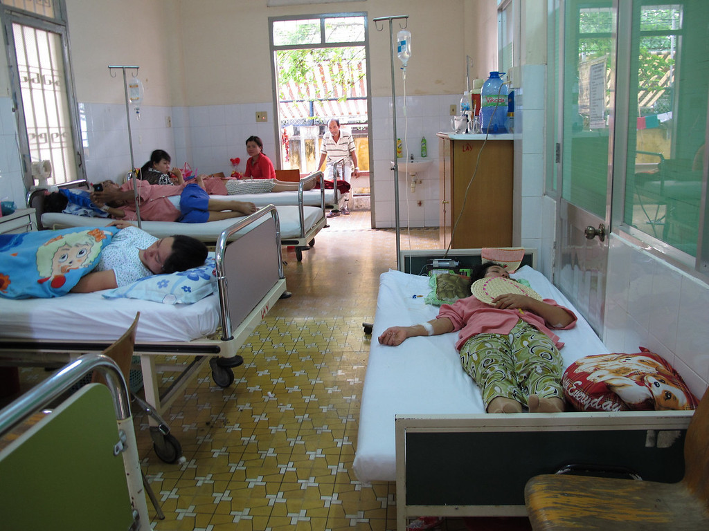 . Patients with dengue fever are treated at Khanh Hoa General Hospital in Nha Trang, Vietnam on Sept. 4, 2013. Mosquitoes are being reared with Wolbachia bacteria that works as a natural vaccine to keep them from becoming infected with the virus that causes dengue. They were released on an island in central Vietnam as part of research to help determine whether the bacteria can help in the fight against the disease. (AP Photo/Margie Mason)