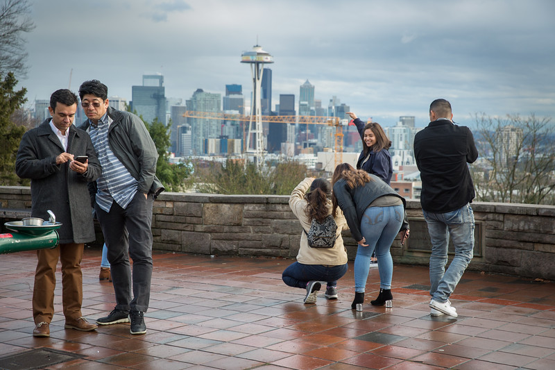 Kerry Park, on Queen Anne Hill is the classic stop to get a scenic and a selfie of the city. Here two tourists check the results of their shot while another group immortalizes their own visit to Seattle.