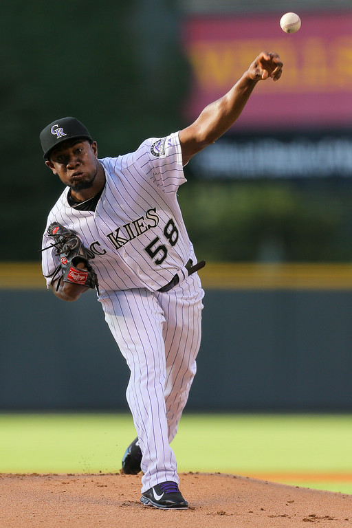. DENVER, CO - JULY 22:  Starting pitcher Yohan Flande #58 of the Colorado Rockies delivers to home plate during the first inning against the Washington Nationals at Coors Field on July 22, 2014 in Denver, Colorado.  (Photo by Justin Edmonds/Getty Images)