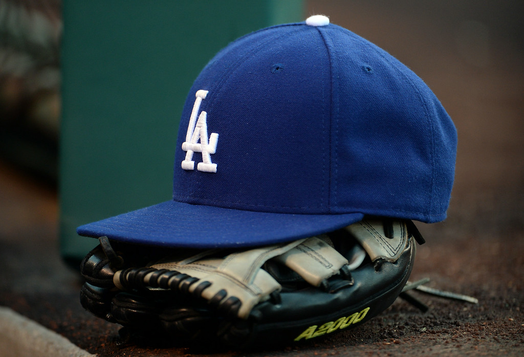 . Los Angeles Dodgers hat and glove prior to a baseball game against the Los Angeles Angels at Anaheim Stadium in Anaheim, Calif., on Thursday, Aug. 7, 2014.  (Photo by Keith Birmingham/ Pasadena Star-News)
