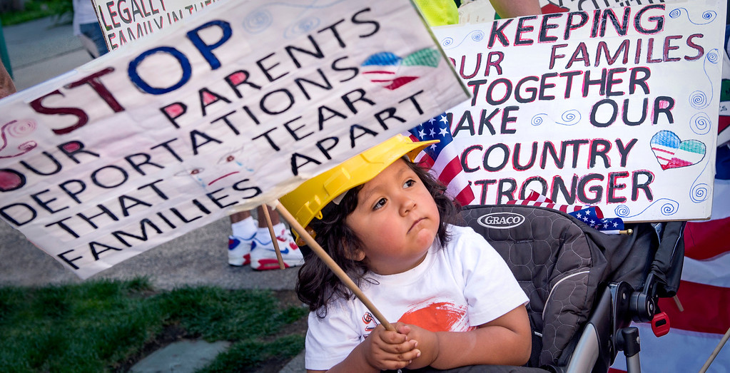 . Simon Rodriguez, 3, carrys a sign opposing deportation of undocumented immigrants.  The Coalition for Humane Immigrant Rights of Los Angeles (CHIRLA) joined area organizations and coalitions to march in honor of worker contributions and denounce deportations of undocumented immigrants living in the United States May 1, 2014.   (Staff photo by Leo Jarzomb/San Gabriel Valley Tribune)