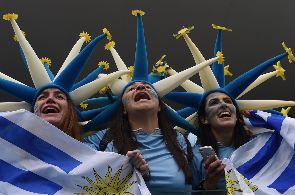 . Uruguayan fans cheer before the start of a Group D football match between Uruguay and England at the Corinthians Arena in Sao Paulo during the 2014 FIFA World Cup on June 19, 2014. (LUIS ACOSTA/AFP/Getty Images)