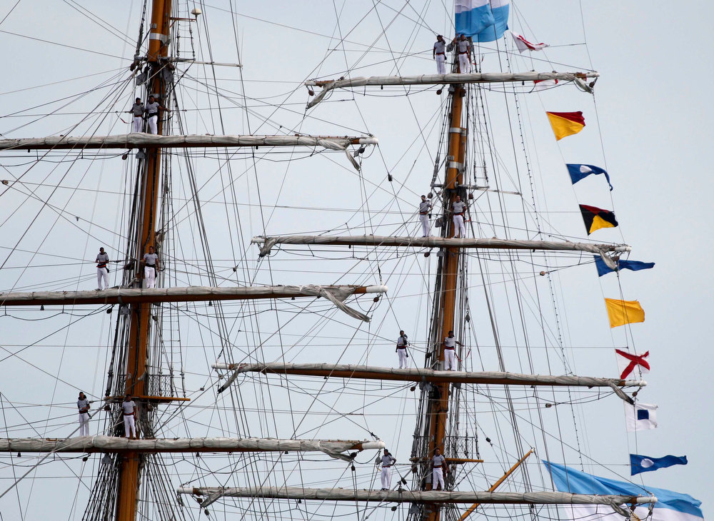 Description of . Sailors stand on the masts of Argentine navy vessel ARA Libertad as it arrives at the harbor of the seaside resort of Mar del Plata January 9, 2013. The tall sailing ship used for training was detained in Ghana since October 2, 2012 at the request of a hedge fund seeking payment on defaulted government bonds. It was later released and left Ghana on December 19, 2012 for Mar del Plata following a ruling by the International Tribunal for the Law of the Sea that Ghana should release the ship after Argentina argued that a U.N. Convention on the law gives warships immunity from civil claims when they dock at foreign ports. REUTERS/Enrique Marcarian