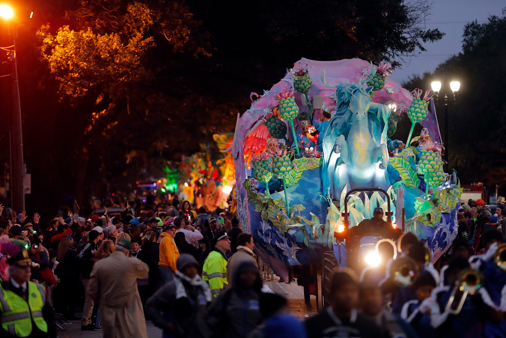 . The Krewe of Orpheus rolls in New Orleans, Monday, Feb. 12, 2018. Tens of thousands of revelers are expected on New Orleans streets for parades and rowdy fun as Mardi Gras caps the Carnival season in a city with a celebration of its own, its 300th anniversary. (AP Photo/Gerald Herbert)