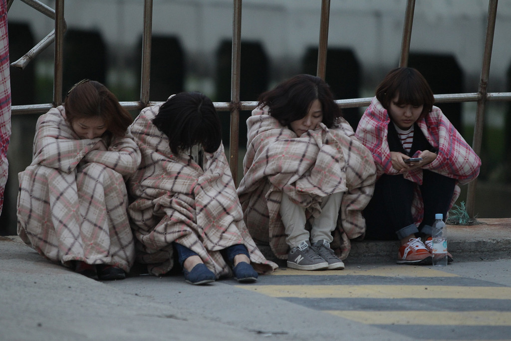 . Relatives of missing people wait at a Jindo port on April 16, 2014 in Jindo-gun, South Korea.  (Photo by Chung Sung-Jun/Getty Images)