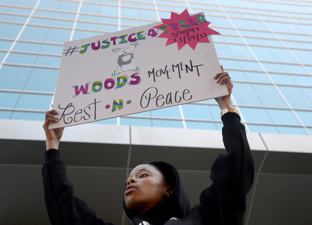 . Tyler Woods\' step sister Shala Woods holds a sign up at a protest for her brother, who was shot by the Long Beach Police Department on Nov. 19, at the rally outside the department headquarters in Long Beach on Sunday, November 24, 2013. (Photo by Sean Hiller/ Daily Breeze).