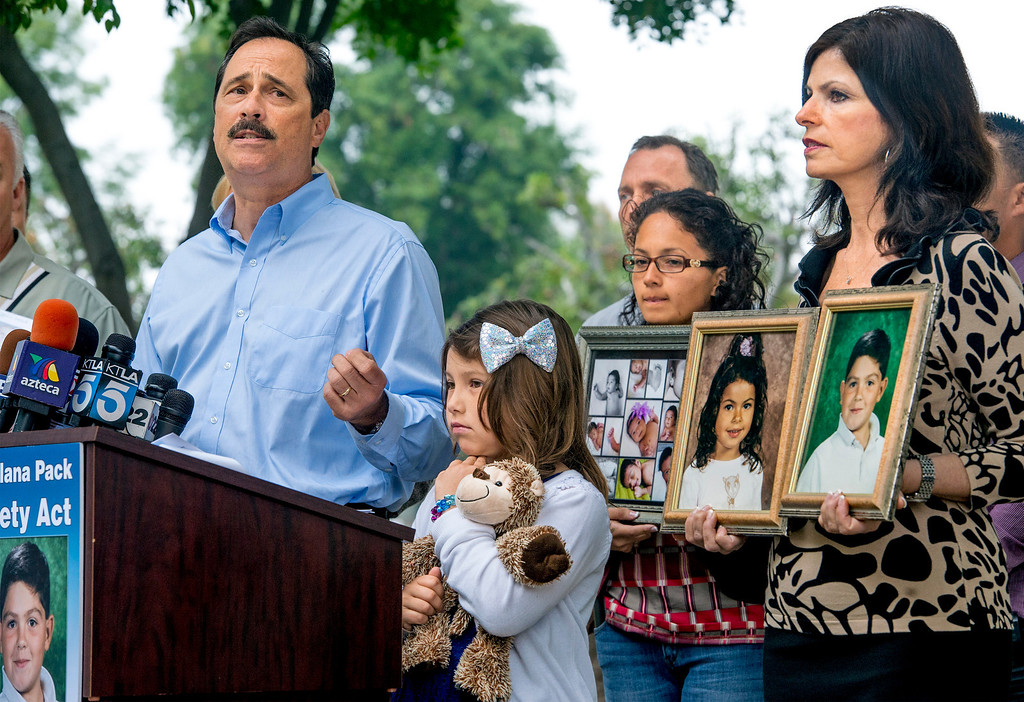 . Bob Pack with wife Carmen and daughter Noelle, 7, of Danville, Calif. speaks at Consumer Watchdog press conference announcing the gathering 840,00 signatures to qualify the placement of The Troy And Alana Pack Patient Safety Act instituting doctor drug testing on November ballot at the Los Angeles County Recorder\'s Office in Norwalk, Calif. March 24, 2014.  The two Pack children were killed by an impaired driver high on over-prescribed medications from Kaiser Permanente.  (Staff photo by Leo Jarzomb/San Gabriel Valley Tribune)
