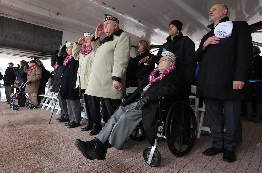 Description of . Pearl Harbor survivors attend a ceremony commemorating the 71st anniversary of the Pearl Harbor attacks on December 7, 2012 in New York City. World War II veterans from the New York metropolitan area participated in a wreath-laying ceremony next to the Intrepid Sea, Air and Space Museum, which was damaged in Hurricane Sandy and is undergoing repairs.  (Photo by John Moore/Getty Images)