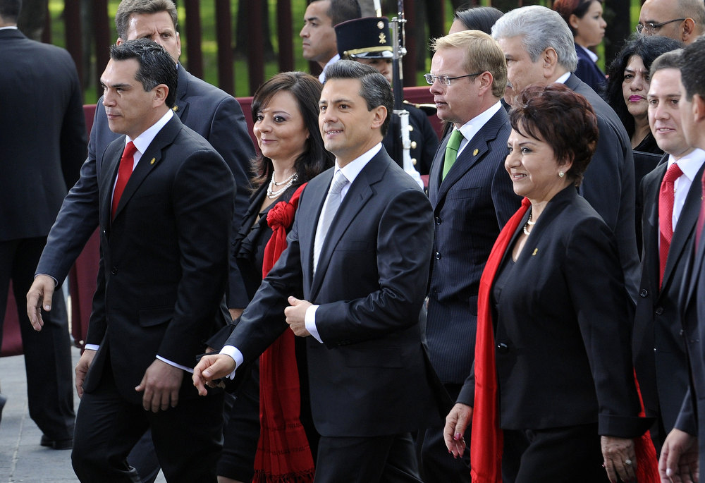 . Enrique Pena Nieto (C) arrives at the Mexican Congress, in Mexico City, on December 01, 2012, for his inauguration as Mexican president. HECTOR GUERRERO/AFP/Getty Images