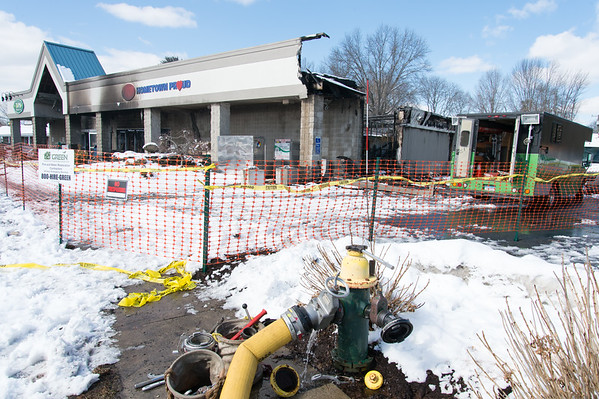 03/04/19 Wesley Bunnell | Staff Fire destroyed Tops Marketplace located at 887 Meriden-Waterbury Tpke in Southington on Monday night. A fire hydrant in use on Monday afternoon.