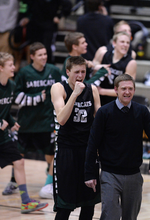 . Ryan Quaid of Fossil Ridge High School (32) celebrates the team\'s 49-46 win over Monarch High School at Monarch High School Gym in Louisville, Colorado on Tuesday, Jan. 28, 2014. (Photo by Hyoung Chang/The Denver Post)