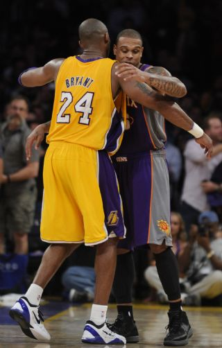 . Lakers #24 Kobe Bryant gives a hug to his old team mate Phoenix #26 Shannon Brown. The Lakers defeated Phoenix Suns 99-83 in a game played at Staples Center in Los Angeles,  CA 1/10/2012 (John McCoy/Staff Photographer)