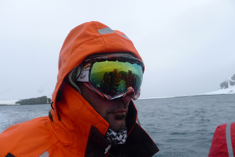 Antarctica - Jan 2013 - Sergey Vavilov Circle Trip, The One Ocean Expedition staff:  Andy Pollitzer steers the Zodiac on in wet conditions...