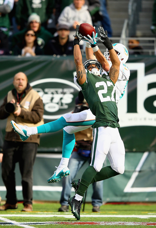 . Dee Milliner #27 of the New York Jets breaks up a pass to  Brian Hartline #82 of the Miami Dolphins during their game at MetLife Stadium on December 1, 2013 in East Rutherford, New Jersey.  (Photo by Al Bello/Getty Images)