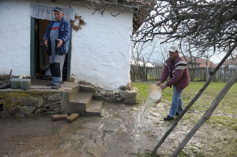 . Relatives of a victim of a shooting, cleans the house after police finished its investigation in the village of Velika Ivanca, 40 kilometers south of capital Belgrade, on April 9, 2013. A man shot dead 13 relatives and neighbors, including a two-year-old child, in a tiny Serbian village on Tuesday, in the country\'s worst killing spree in two decades.  AFP PHOTO / ALEXA STANKOVIC