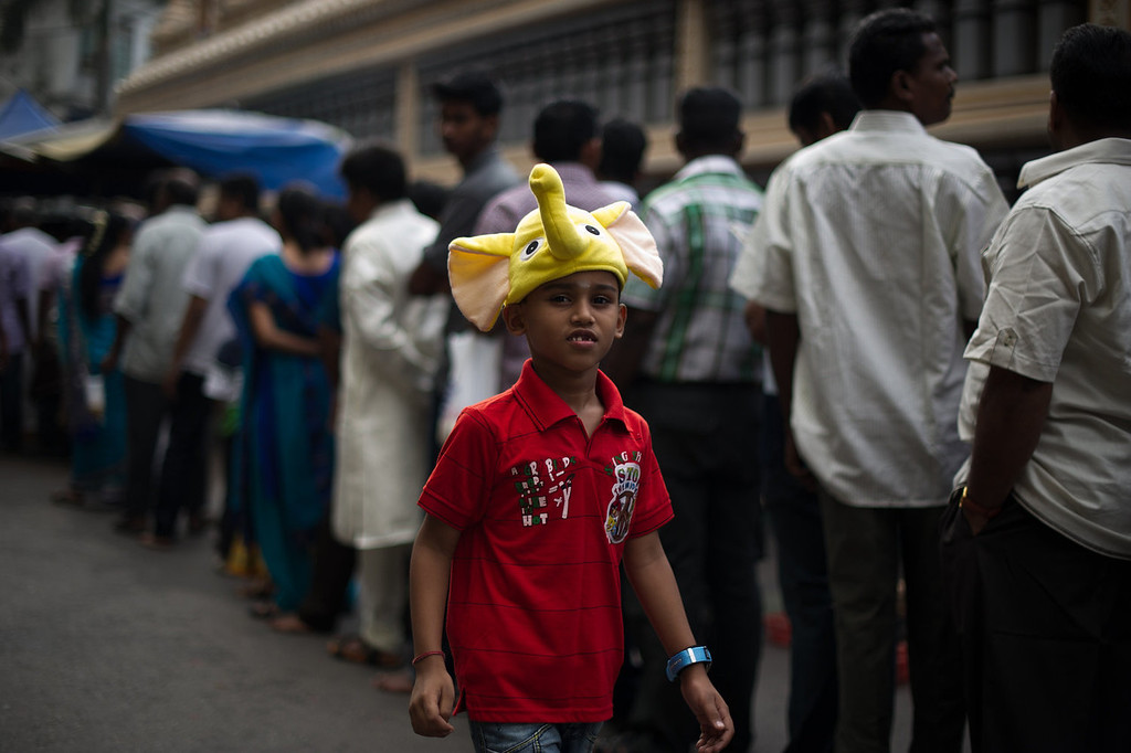 . A Malaysian Hindu boy wears a headband costume during the Diwali celebrations at a temple in the capital Kuala Lumpur on November 2, 2013. The Hindu festival of light, Diwali marks the homecoming of the God Lord Ram after vanquishing the demon king Ravana and symbolises taking people from darkness to light and the victory of good over evil. MOHD RASFAN/AFP/Getty Images