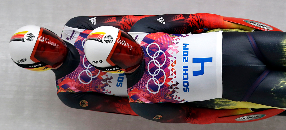 . The doubles team of Tobias Arlt and Tobias Wendl of Germany speed down the track in their final run during the men\'s doubles luge at the 2014 Winter Olympics, Wednesday, Feb. 12, 2014, in Krasnaya Polyana, Russia. (AP Photo/Michael Sohn)