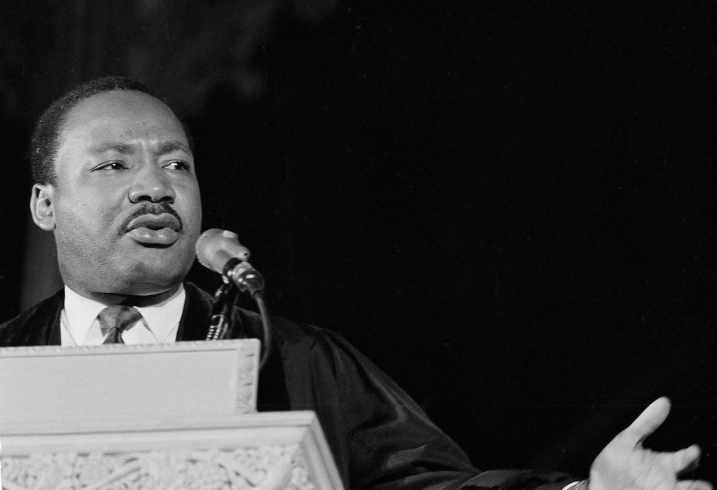 """. Dr. Martin Luther King, Jr., left, who heads the Southern Christian Leadership Conference, addresses a capacity crowd from the pulpit at the National Cathedral in Washington, D.C., March 31, 1968. Discussing his proposed demonstrations at the capital, tentatively set for June 15, Dr. King said \""""We\'re not coming to tear Washington apart. We\'re coming to demand to know if the government will address itself to the problems of poverty.\"""" (AP Photo/John Rous)"""