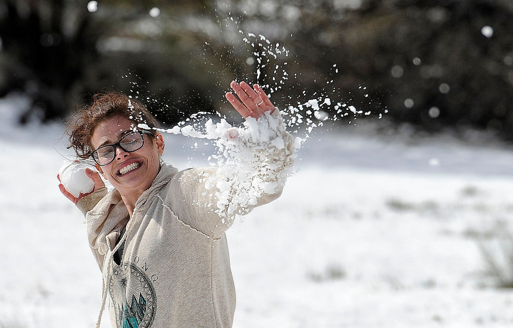 . Sally DiGirolamo, Burbank, stopped in Gorman with boyfriend Chris Carlberg to have some fun in the snow. The couple were on their way to Santa Cruz to visit family. (Hans Gutknecht/Staff Photographer)