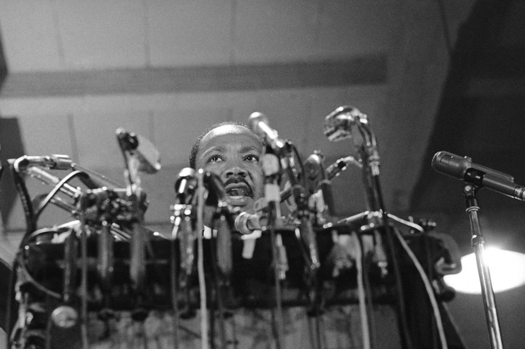 . Dr. Martin Luther King, head of the Southern Christian Leadership Conference, delivers his speech that opened The National Conference for New Politico Convention in Chicago, Sept. 1, 1967. King, facing a battery of microphones, called for an end of the Vietnam fighting. (AP Photo/Charles Harrity)
