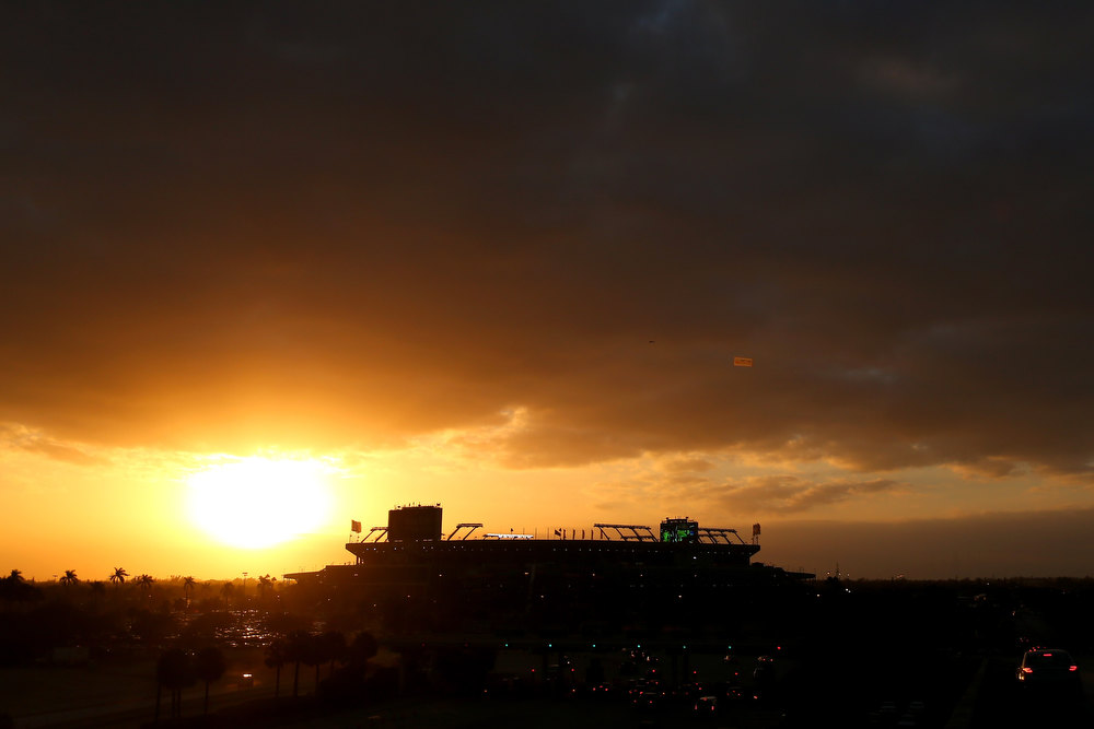 . A general exterior view of the sun setting behind Sun Life Stadium prior to the Florida State Seminoles playing against the Northern Illinois Huskies during the Discover Orange Bowl at Sun Life Stadium on January 1, 2013 in Miami Gardens, Florida.  (Photo by Mike Ehrmann/Getty Images)