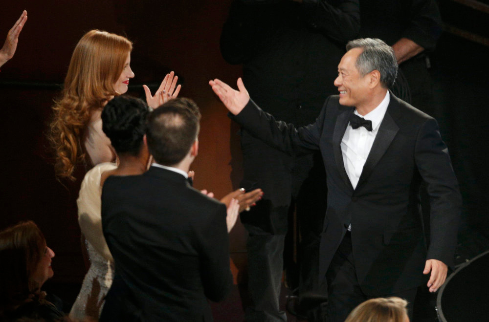 Description of . Director Ang Lee reacts after winning the Oscar for best director for
