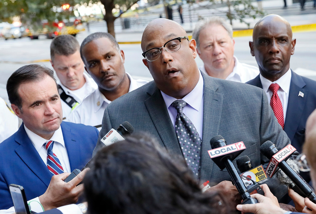 . Cincinnati Police Chief Eliot Isaac, center, speaks alongside Mayor John Cranley, left, during a media conference as emergency personnel and police work the scene of shooting near Fountain Square, Thursday, Sept. 6, 2018, in downtown Cincinnati. (AP Photo/John Minchillo)