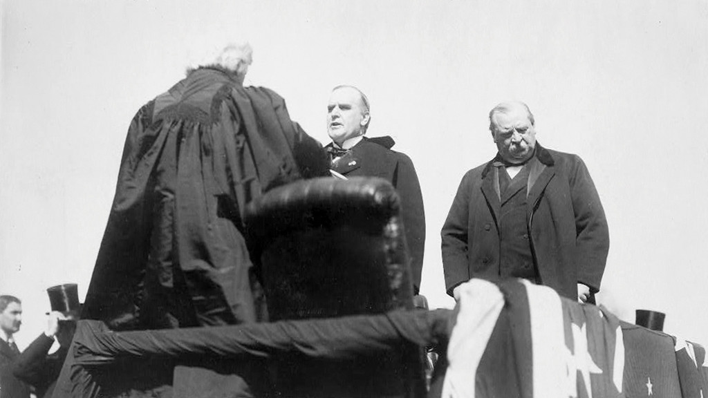 . In this image provided by the Library of Congress Chief Justice Melville Weston Fuller administering the oath of office to Major William McKinley during at his inauguration as President of the United States in Washington in 1897 circa, as outgoing President Grover Cleveland looks on at right. (AP Photo/Library of Congress)