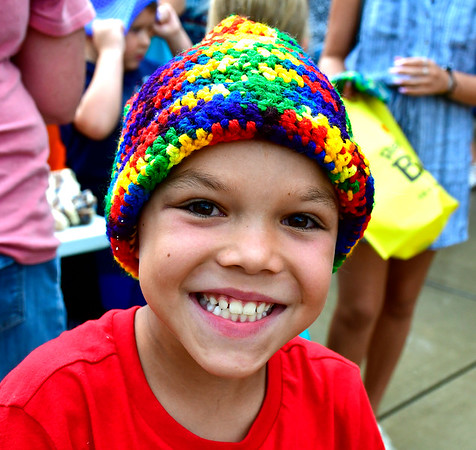 8/22/2019 Mike Orazzi | Staff Luke Hull,8, wears a new knit hat he got during the second annual Mayors Back to School Pencil Hunt held at Muzzy Field in Bristol on Thursday evening.