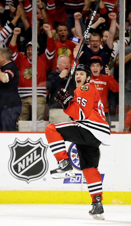 . Chicago Blackhawks center Andrew Shaw (65) celebrates after scoring the winning goal during the third overtime period of Game 1 in their NHL Stanley Cup Final hockey series against the Boston Bruins, Thursday, June 13, 2013, in Chicago. (AP Photo/Nam Y. Huh)