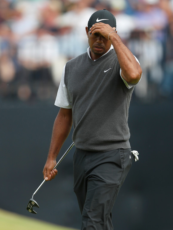. Tiger Woods of the US after putting on the 13th green during the third round of the British Open Golf Championship in Carnoustie, Scotland, Saturday July 21, 2018. (AP Photo/Alastair Grant)