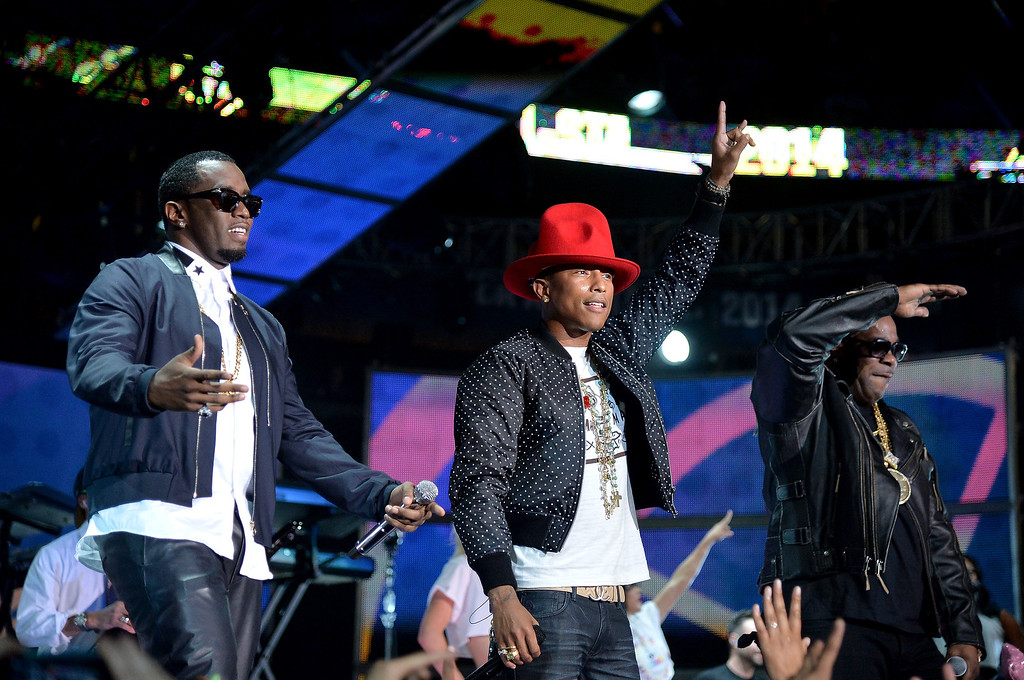 . Sean Combs, Pharrell Williams, and Busta Rhymes perform onstage at the 63rd NBA All-Star Game 2014 at the Smoothie King Center on February 16, 2014 in New Orleans, Louisiana.  (Photo by Mike Coppola/Getty Images)